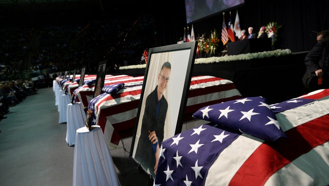 Caskets and pictures of firefighters killed in the Texas fertilizer plant explosion are displayed during a memorial service at Baylor University.