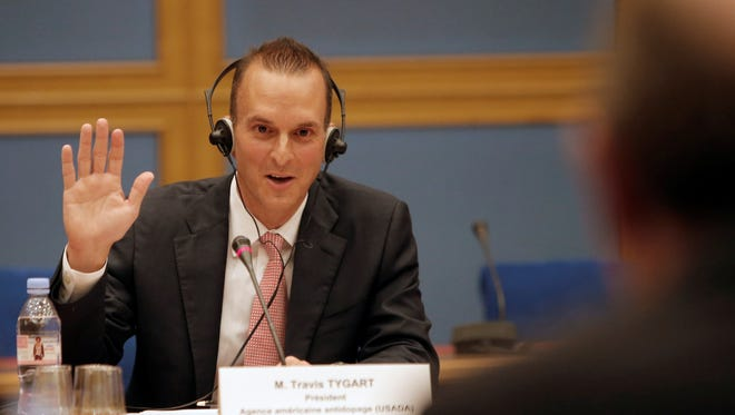 The head of the U.S. Anti-Doping Agency (USADA), Travis Tygart, takes an oath prior to answering questions before a senate-led inquiry into the fight against doping in Paris on Thursday.