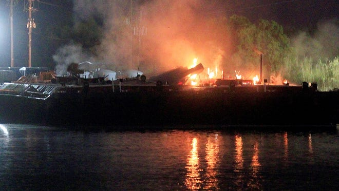 Fire burns aboard a fuel barge near Mobile Alabama on Wednesday.