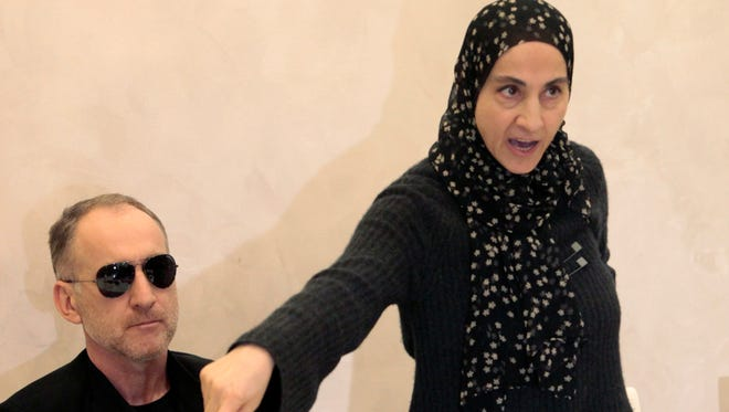 The mother of the two Boston bombing suspects, Zubeidat Tsarnaeva, with the suspects' father Anzor Tsarnaev, left, speaks at a news conference in Makhachkala, the southern Russian province of Dagestan, on Thursday.