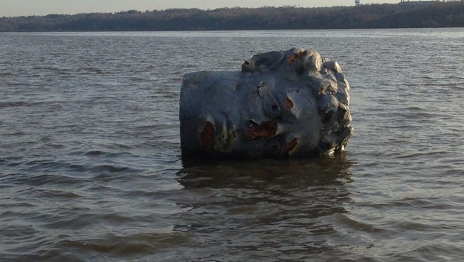 A giant head made of Styrofoam and fiberglass is seen floating in the Hudson River in Poughkeepsie, N.Y.