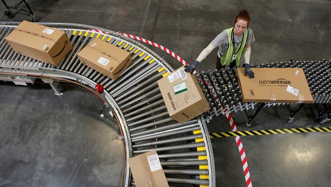 Katherine Braun sorts packages at an Amazon.com fulfillment center in Goodyear, Ariz.