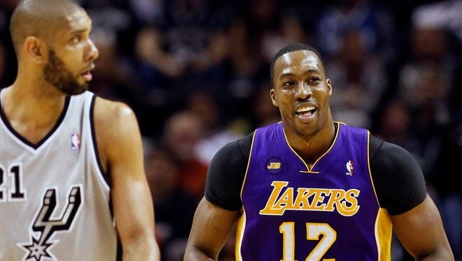 Lakers center Dwight Howard shrugs off an offensive foul call as Tim Duncan looks on during Game 2 on Wednesday night.