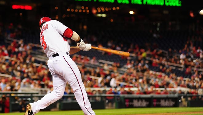 Washington Nationals second baseman Danny Espinosa hits a two run home run in the third inning against the Cincinnati Reds at Nationals Park.