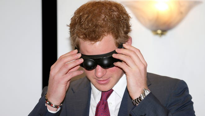 Prince Harry dons goggles to get an idea of what it's like to have a brain injury, during a visit to Nottingham to promote the Headway charity.