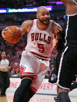 Bulls forward Carlos Boozer drives against Nets center Andray Blatche during Game 3 of their first-round series.