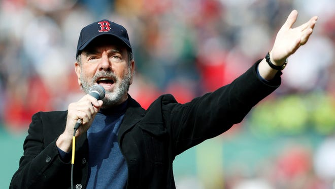 Neil Diamond sings 'Sweet Caroline' in the eighth inning of a baseball game between the Boston Red Sox and the Kansas City Royals in Boston on April 20.