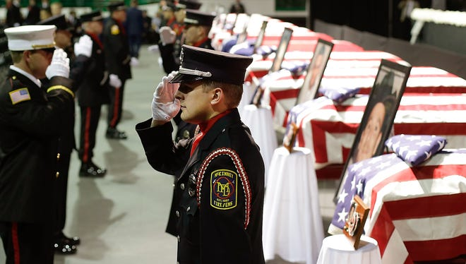 An honor guard salutes during a shift change before a memorial service April 25 for first responders who died in a fertilizer plant explosion. Fourteen firefighters and other first responders were killed April 17 when a burning fertilizer plant exploded in West, Texas.