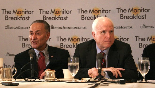 Sen. Charles Schumer, D-N.Y., and Sen. John McCain, R-Ariz., discuss their immigration bill during a breakfast hosted by The Christian Science Monitor on April 25.
