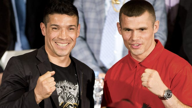Middleweight champion Sergio Martinez, left, poses with England's Martin Murray during news conference in Buenos Aires Wednesday. They will fight for the WBC middleweight title Saturday.