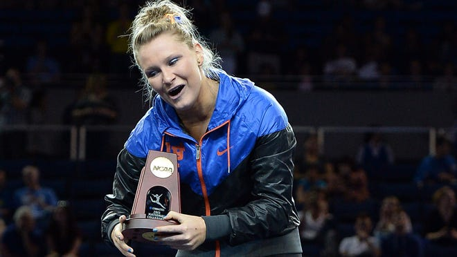 Florida's Bridget Sloan celebrates her NCAA title in the balance beam. That capped a weekend that also brought the national all-around title and the Gators' first-ever team championship.