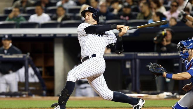 New York Yankees catcher Francisco Cervelli hits a solo home run against the Toronto Blue Jays during the fourth inning at Yankee Stadium.