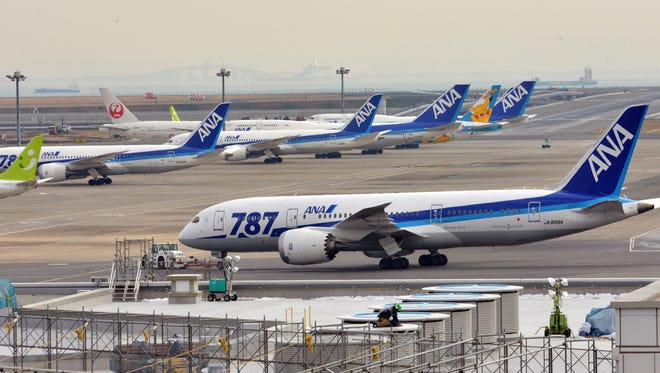 This file picture taken on Jan. 16, 2013, shows an All Nippon Airways' (ANA) Boeing 787 dreamliner towed by a tractor at Tokyo's Haneda airport.