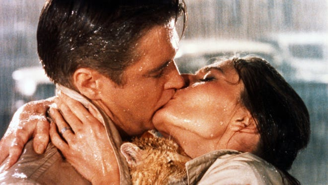 """George Peppard and Audrey Hepburn in a scene from, """"Breakfast at Tiffany's."""""""