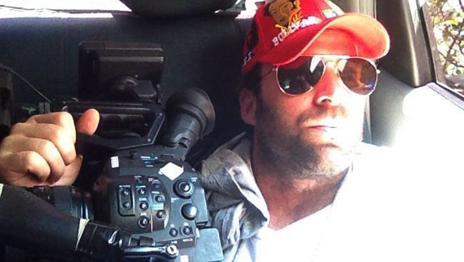 This undated family photo released Thursday shows Timothy Tracy inside of a vehicle in Venezuela.
