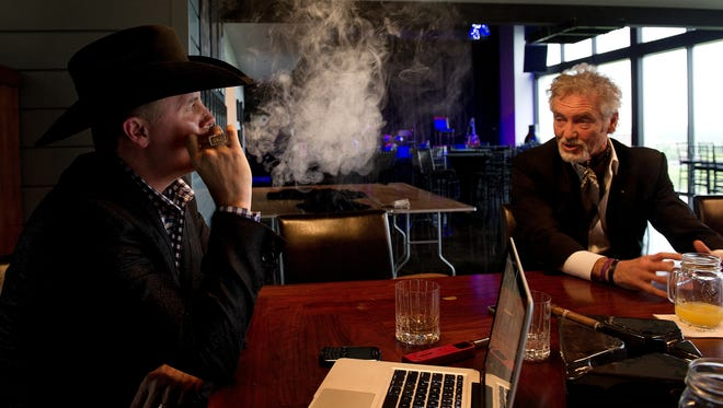 John Rich and Larry Gatlin sit at a bar in Rich's Nashville home and share memories of George Jones who died Friday, April 26, 2013.