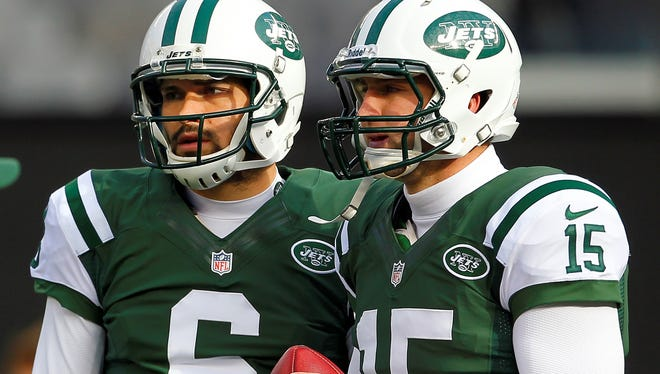 Mark Sanchez, left, and Tim Tebow are among six quarterbacks on the Jets roster.