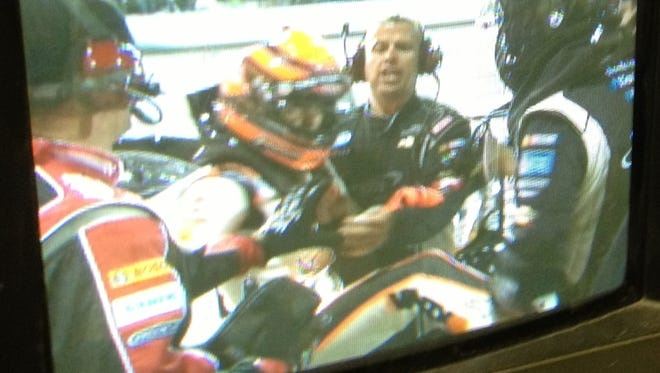 """This image from a SPEED TV monitor shows footage of Nelson Piquet Jr. kicking driver Brian Scott below the belt. The footage will air Saturday morning on the network's """"SPEED Center"""" show."""