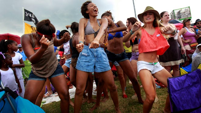 On May 6, 2012, audience members dance the 'Sissy Bounce' during the 'Bounce Shakedown' at the New Orleans Jazz and Heritage Festival.