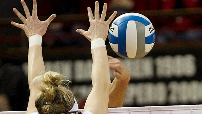 Quinnipiac University agreed to keep volleyball in a settlement in a Title IX case.