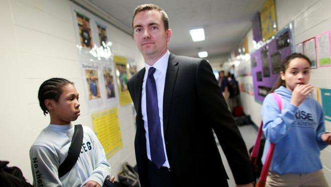 Educator Ryan Hill walks the hallways of The Rise Academy in Newark, N.J.