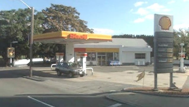 The owner of a Mercedes SUV hijacked by two Boston bombing suspects tells the Boston Globe that he escaped by jumping from the vehicle while it was stopped at this Shell station in Cambridge, Mass., while the suspects got gasoline.