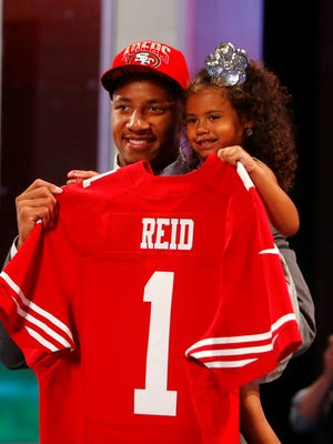 Eric Reid holds daughter LeiLani Reid after being introduced as the No. 18 overall pick to the San Francisco 49ers during the 2013 NFL Draft at Radio City Music Hall.