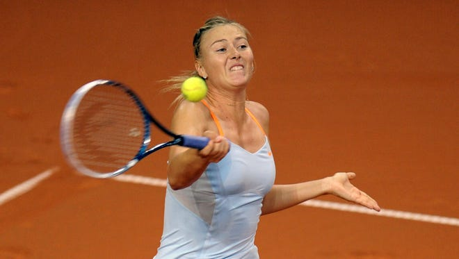Maria Sharapova of Russia fires a forehand during her three-set victory Saturday against Germany's Angelique Kerber.