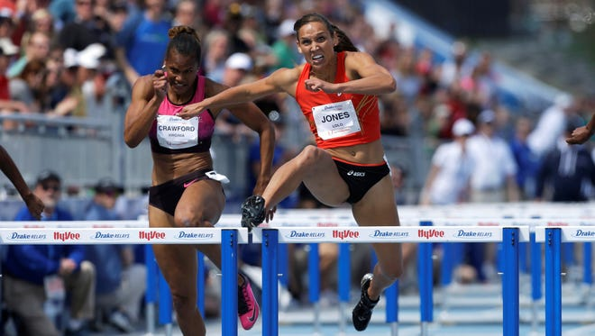 Lolo Jones, right, clears the final hurdle ahead of Virginia Crawford  during the women's  100-meter hurdles at the Drake Relays on Saturday in Des Moine.