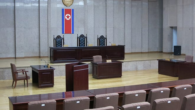A North Korean flag hangs inside the interior of Pyongyang's Supreme Court.   North Korea says it will soon deliver a verdict in the case of detained American Kenneth Bae.