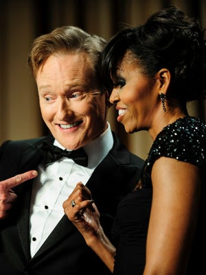 Comedian Conan O'Brien and first lady Michelle Obama have some fun during the White House Correspondents' Association Dinner in Washington, D.C.