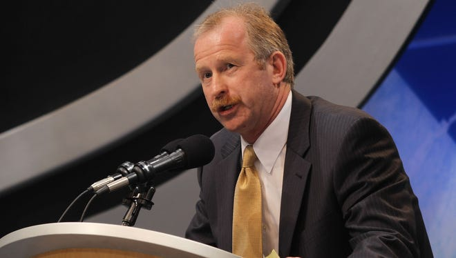 Jim Nill works the draft floor for the  Detroit Red Wings in 2010.