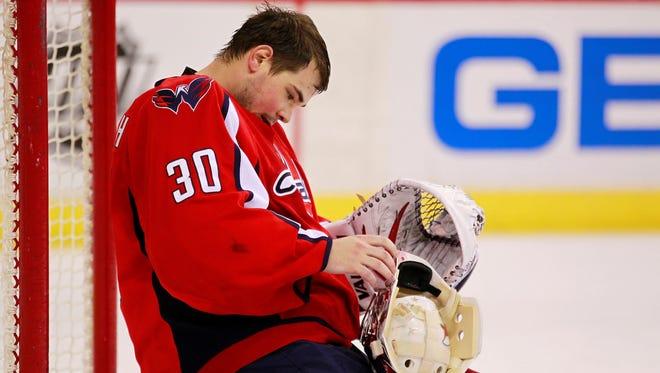 Washington Capitals goalie Michal Neuvirth  adjusts his mask in a recent game against the Ottawa Senators.