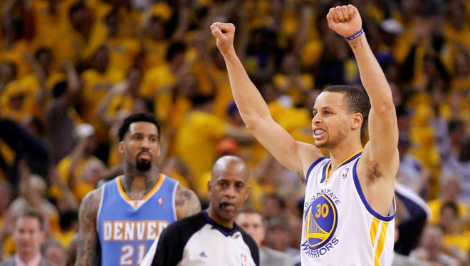 Stephen Curry celebrates after the Golden State Warriors defeated the Denver Nuggets 110-108 in Game 3  of their first-round NBA playoff series Friday.