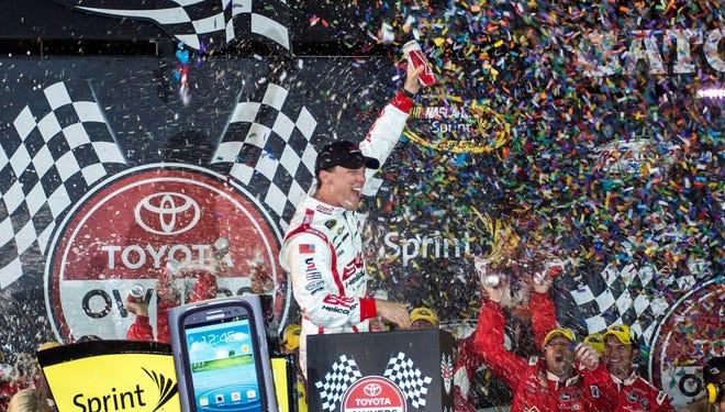 Kevin Harvick celebrates winning the Toyota Owners 400 at Richmond International Raceway.