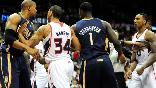 Indiana Pacers power forward David West (far left) is confronted by Atlanta Hawks point guard Jeff Teague (far right) after fouling Hawks center Al Horford (not shown) in Saturday's game.
