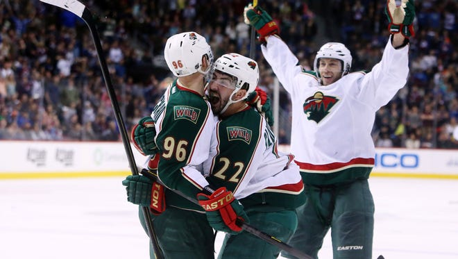 Minnesota Wild winger Pierre-Marc Bourchard (96) is greeted by right wing Cal Clutterbuck (22) after scoring a goal during the third period.