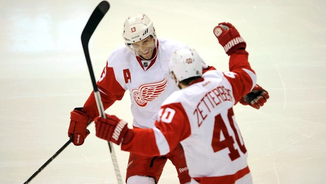 Detroit Red Wings center Pavel Datsyuk (13) and center Henrik Zetterberg (40) celebrate a goal during the third period on Saturday.