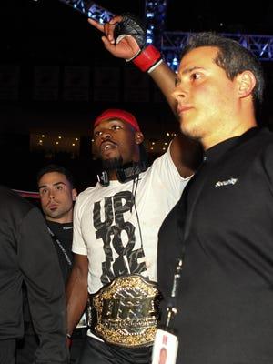 Jon Jones celebrates his victory over Chael Sonnen at UFC 159.