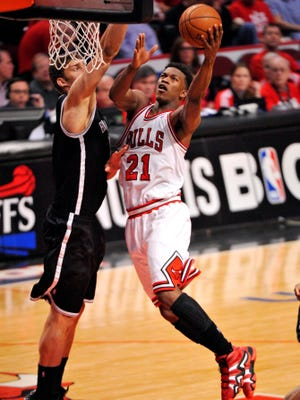 Chicago Bulls small forward Jimmy Butler (21) goes to the basket against Brooklyn Nets center Brook Lopez (11) in the second half during game four of the first round of the 2013 NBA playoffs at the United Center.