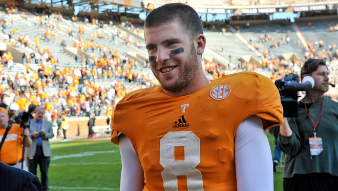 Tennessee quarterback Tyler Bray smiles as he leaves the field after his team defeated Troy  55-48.