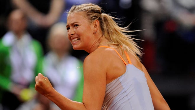 Maria Sharapova of Russia defeats Li Na of China on Sunday in the final of the Porsche Grand Prix in Stuttgart, Germany.