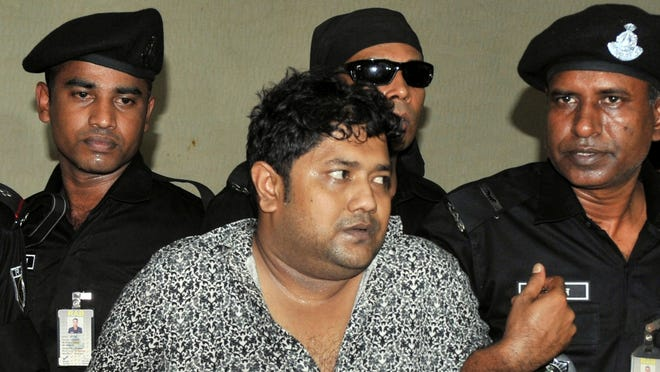 Mohammed Sohel Rana, the fugitive owner of an illegally-constructed building that collapsed last week in Bangladesh, is paraded by Rapid Action Battalion commandoes in Dhaka, Bangladesh, on Sunday.