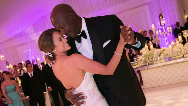 Michael Jordan dances with his bride Yvette Prieto during their wedding reception at the Bear's Club in Jupiter, Fla.
