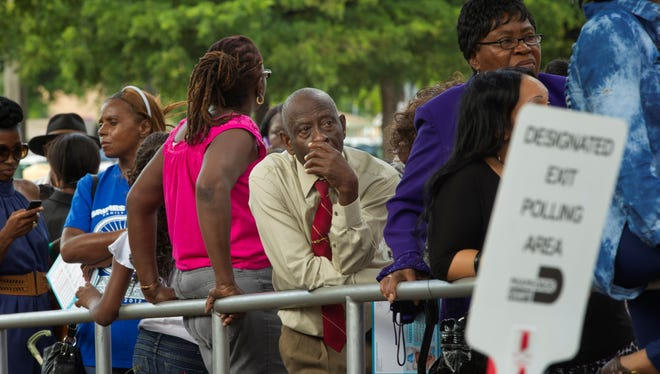 Florida residents wait in line to cast their votes in the 2012 presidential election.