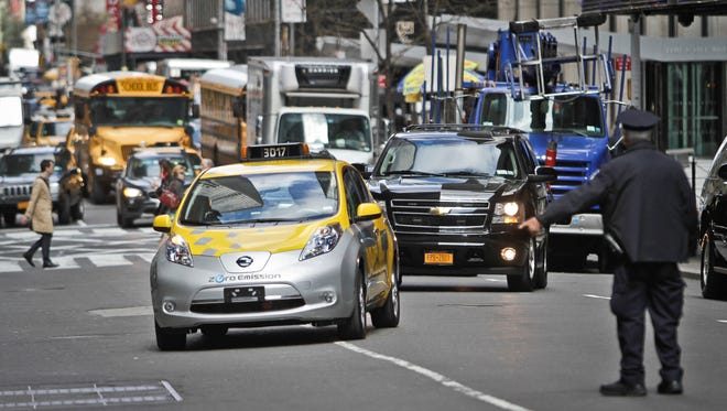 Mayor Michael Bloomberg arrives in an electric taxicab for a news conference on April 22 in New York.