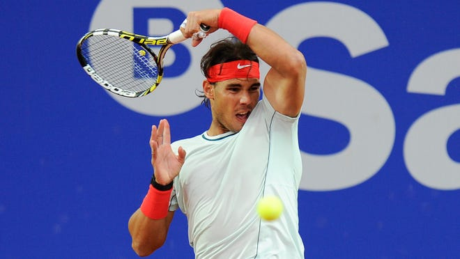 Rafael Nadal of Spain wins the Barcelona Open for the eighth time.