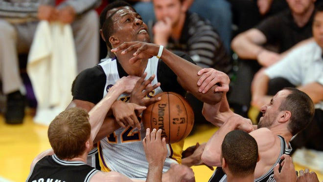 Lakers center Dwight Howard runs into a gaggle of Spurs during Game 4.