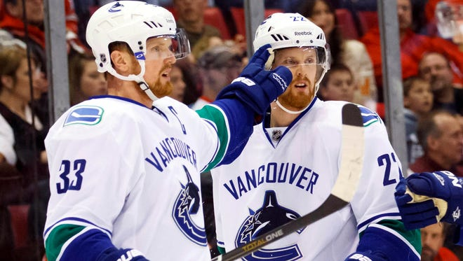 The Sharks will have their hands full with Vancouver Canucks twins Henrik, left, and Daniel Sedin.