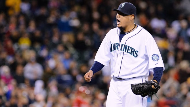 Seattle Mariners starting pitcher Felix Hernandez elebrates after the final out of the eighth inning against the Los Angeles Angels at Safeco Field.
